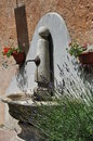 Mediterranean water fountain, lavender and geranium flower Royalty Free Stock Photo