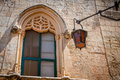 Medivial architectured window with old light in mdina malta Stock Photos