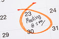 Meeting appointment written in a calendar. Royalty Free Stock Photo