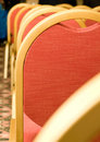 Meeting. Closeup of red Chair back Royalty Free Stock Image