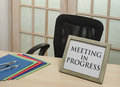Meeting in progress sign front of closed doors Stock Photography