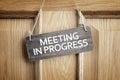 Meeting in progress sign on office door Royalty Free Stock Photo