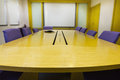Meeting room with wooden table armchairs projector and white board office interior Stock Image