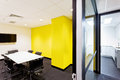 Meeting room with yellow walls hallway to kitchen Royalty Free Stock Photo