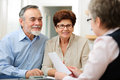 Meeting senior couple discussing financial plan with consultant Royalty Free Stock Photo