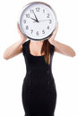 Meeting time will be declared in five minutes young woman hiding her face with a wall clock Royalty Free Stock Photos