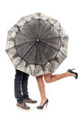Meeting under a umbrella female and man s legs Stock Photography