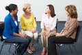 Meeting of women s support group having a discussion Stock Photography