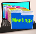 Meetings folders laptop means talk discussion or conference meaning Royalty Free Stock Photography