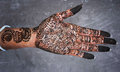 Mehndi hand bridal design art on slate background or henna is a paste that is bought in a cone shaped tube and is made into Stock Image
