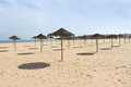 Meia praia lagos algarve portugal sun shades in a row at in europe Royalty Free Stock Photo