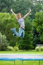 Meisje op Trampoline Stock Foto
