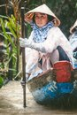MEKONG, VIETNAM. Woman with her boat carrying tourists Royalty Free Stock Photo