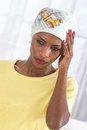Melancholic and sad woman wearing a headscarf beautiful african Royalty Free Stock Images