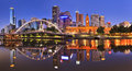 Melbourne cbd river rise cityline at sunrise reflecting bright city illumination lights in still yarra waters Stock Photos