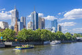 Melbourne skyline with sightseeing ferry and restaurant Royalty Free Stock Photo