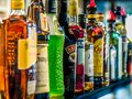 Row of alcoholic bottles on display Royalty Free Stock Photo