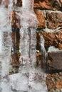Melting Ice On Old Brick Wall