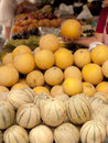Melon stall in the market with greengrocer choosing one Royalty Free Stock Images