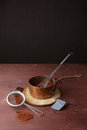 Melted chocolate in pan with whisk on the wooden background Royalty Free Stock Photo