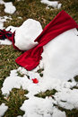 Melted snowman on grass Stock Photo