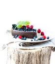 Melting ice cream with chocolate glaze and berries. Royalty Free Stock Photo