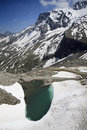 Melting snow in the zillertaler alps austria near tuxer fernerhaus at height of m and ice is at end of june hintertux glacier is Royalty Free Stock Photography