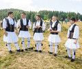 Members of the Greek dance ensemble at the festival Rozhen 2015 in Bulgaria Royalty Free Stock Photo