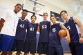 Members Of Male High School Basketball Team With Coach Royalty Free Stock Photo