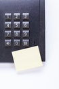 Memo post it message on telefone in office reminder object business Stock Photography