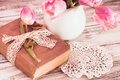Memo still life with book key vintage lace and pink tulips Stock Image