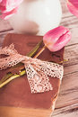 Memo still life with book key vintage lace and pink tulips Royalty Free Stock Photos