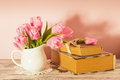 Memo still life with books key and pink tulips Royalty Free Stock Photo
