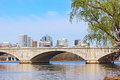 The Memorial Bridge over Potomac River and a city skyline during cherry blossom in Washington DC. Royalty Free Stock Photo