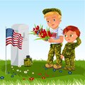 Memorial Day, man with children on military cemetery near grave with white monument to veteran, boy memory and remember