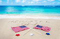 Memorial day background on the sandy beach near ocean Royalty Free Stock Image