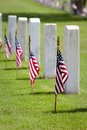 Memorial day cemetery american flags on gravesites commemorate at at united states national Royalty Free Stock Photo