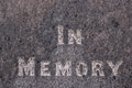 In memory inscribed on a gravestone white words written grey marble Royalty Free Stock Photo