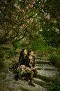 Memory for romatic sakura two pretty women and the beautiful dance of cherry blossom of a tree in spring time Stock Photos