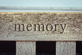 Memory the word carved into a wooden bench Stock Photography