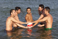 Men with ball in water five adult Royalty Free Stock Images
