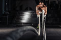 stock image of  Men with battle ropes exercise