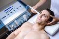 Men in a beauty clinic by becoming treatment Royalty Free Stock Images