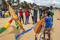 Men and boys inspect a large kite on Negombo beach prior to take off. Royalty Free Stock Photo