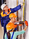 Men in builder uniform happy group indoor Stock Photography