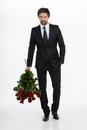 Men with bunch of roses handsome young businessman holding a red and standing against white background Stock Photo