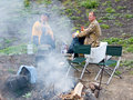 Men beside campfires Royalty Free Stock Image