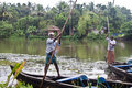 Men in canoe in Backwaters Stock Photo