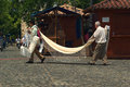 Men carrying a hammock for sale santa fe colombia march on march in the small town of santa fe in colombia Royalty Free Stock Photos