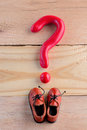 Men casual shoes and a question mark Royalty Free Stock Photo